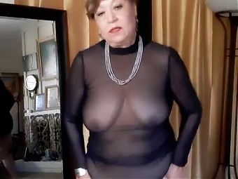 Dancing naked in a transparent dress. Mature 67 year woman