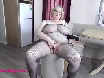 Granny in fishnets with huge tits and shaved pussy