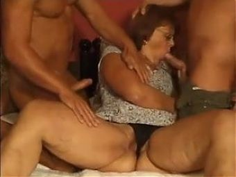 CHUBBY GRANNY WITH GLASSES FUCKED AND Dped BY TWO MEN