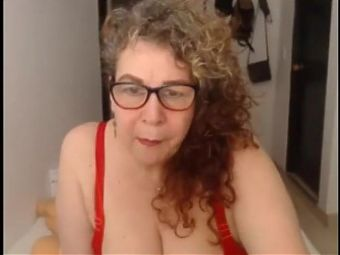 Granny plays with her ass