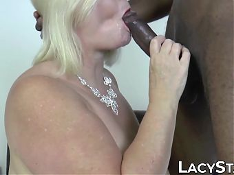 Busty granny Lacey Starr eats jizz after interracial banging